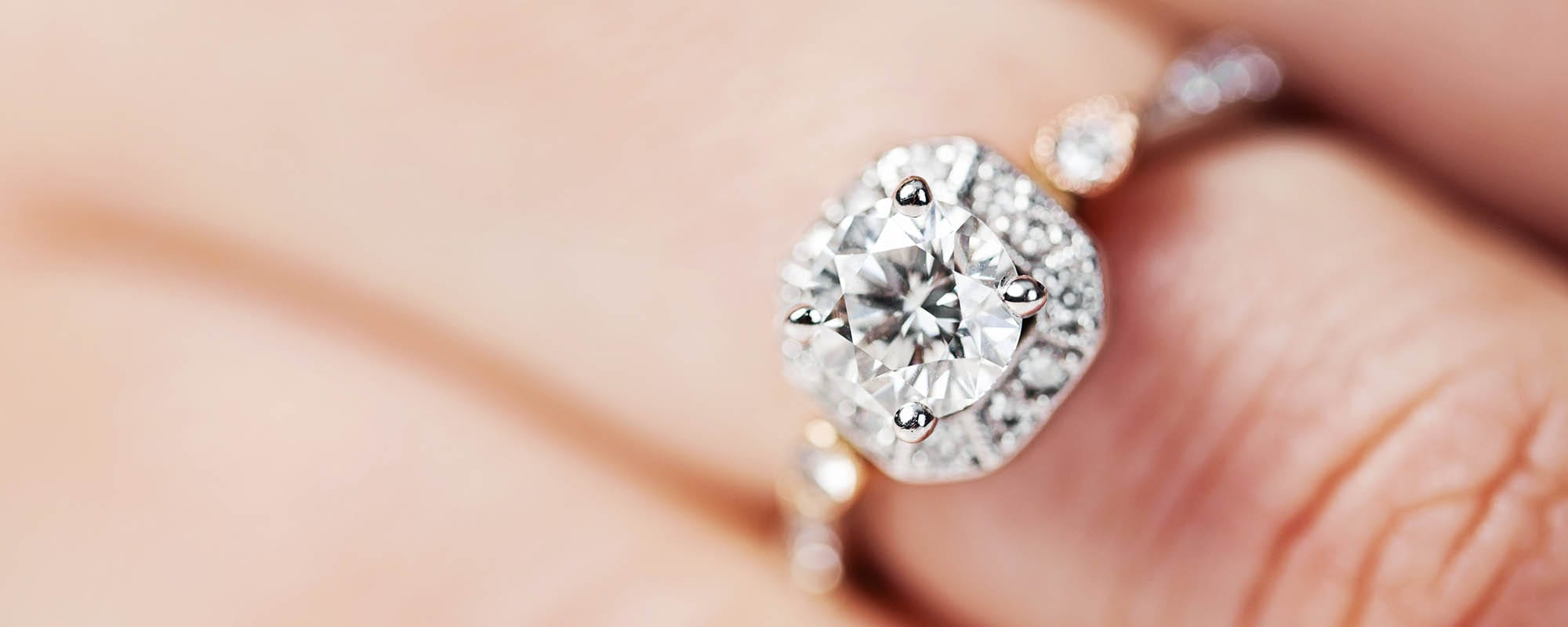 finger with diamond ring